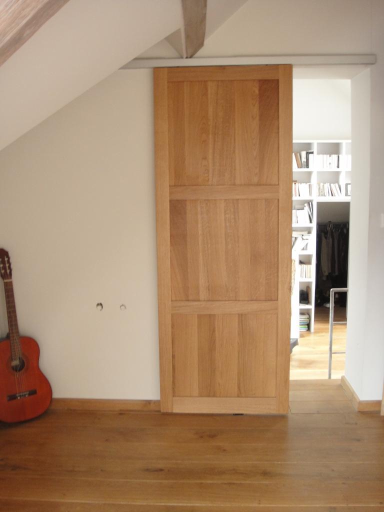 Porte coulissante pleine for Porte a galandage bois